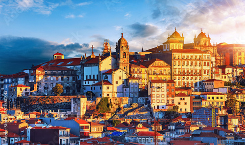 Fotografie, Obraz Porto, Portugal. Sunset above old portuguese town scenic sky