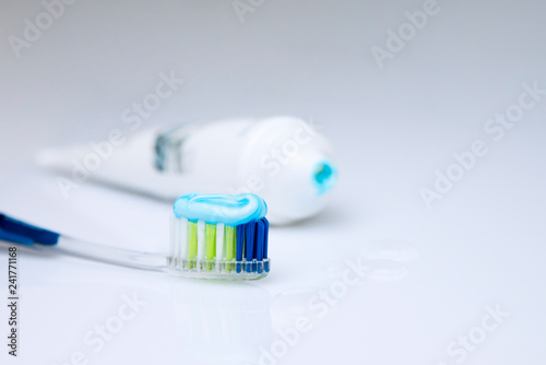 Colorful toothbrushes on a light background