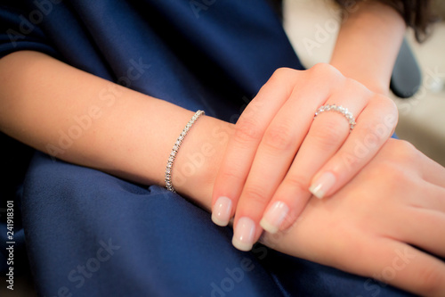 Valokuva hand with diamong ring and wristlet