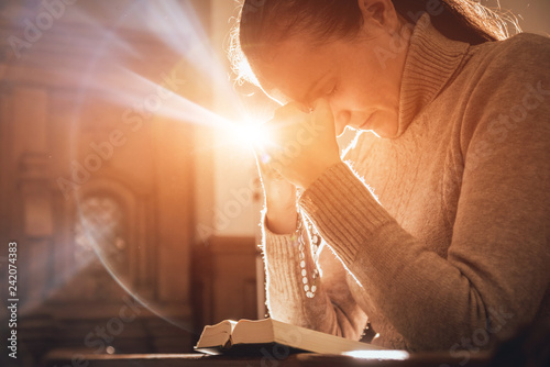 Fototapeta Christian woman praying in church