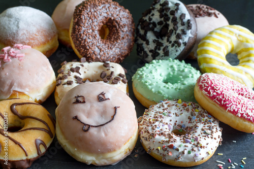 Doughnuts donuts various types of cakes abstract fat thursday concept Fototapeta