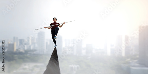 Fotografia Brave ropewalker on cable. Mixed media