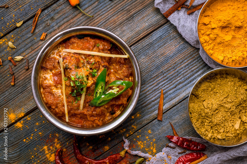 chicken tikka masala Indian food on wooden background with spices