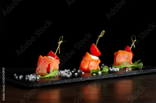 Fotomural Finger food. Rolls of salmon with cream cheese.