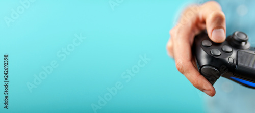 Male hands holding a gaming controller