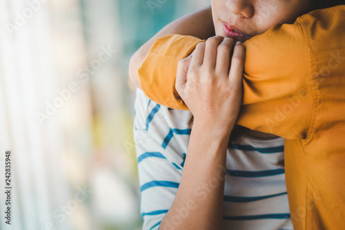 Wallpaper Mural Young depressed asian woman hug her friend for encouragement, Selective focus, PTSD Mental health concept