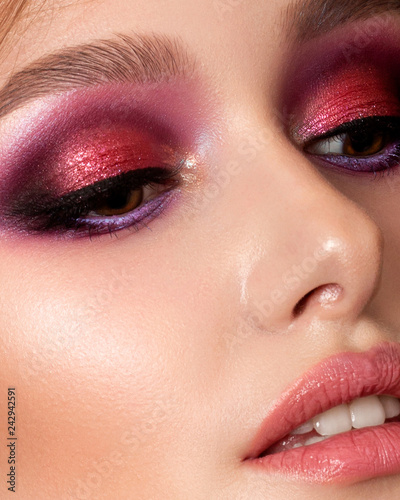 Fotografiet Closeup portrait of young beautiful woman with bright pink smokey eyes and lips