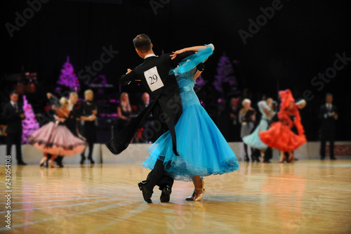 young couple athletes dancers competition in ballroom dancing Fototapet
