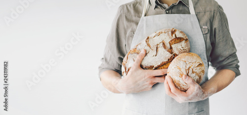 Photographie Baker or chef holding fresh made bread