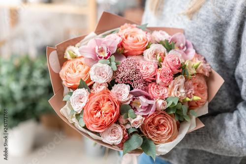 beautiful fresh cut bouquet of mixed flowers in woman hand Fototapeta