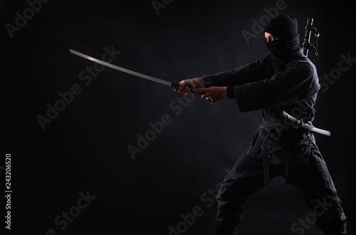 Photo Ninja, samurai warrior on a dark background