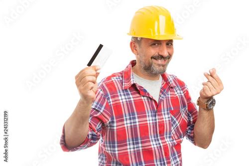 Fototapeta Builder showing card and money gesture.