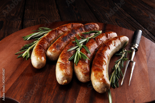 Grilled sausages with spices on a wooden table - Home-made Pork Sausages