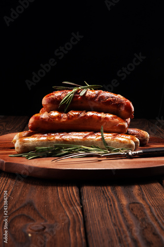 Grilled sausages with spices on a wooden table - Home-made Pork Sausages Fototapeta