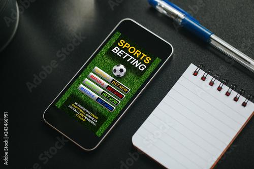 Wallpaper Mural Sports betting app in a mobile phone screen.