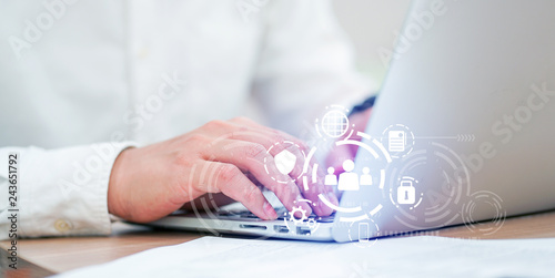 close up asian working man using laptop at home office with virtual interface of GDPR (General Data Protection Regulation ) , privacy personal data concept