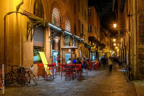 Fotografie, Obraz Old narrow street in Bologna, Emilia Romagna, Italy
