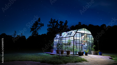 Fotografiet Night greenhouse lighted with stars