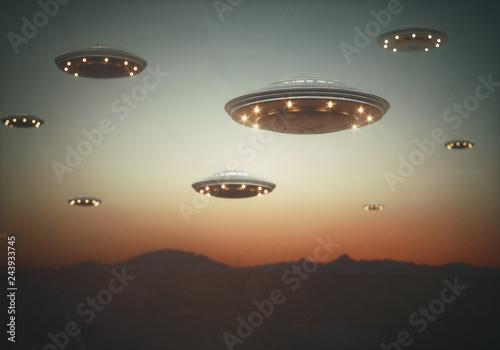 Invasion of alien spaceships under the sky at sunset Fototapeta