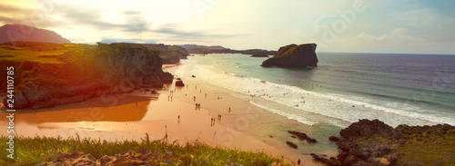 View of beach and rocks at sunset, San Martin beach, in Celorio, province of Asturias