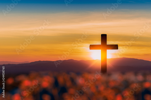 Canvas Silhouette of cross on mountain sunset background.