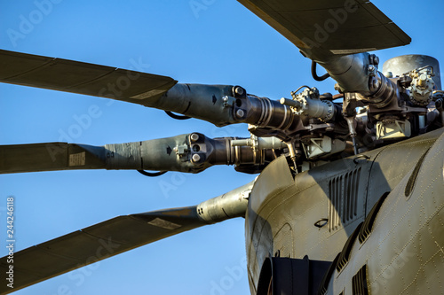Military helicopter rotor blade detail closeup on background blue sky and clouds