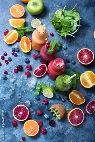Canvas Print Colorful detox smoothie in bottles, summer diet fresh drink for breakfast or snack