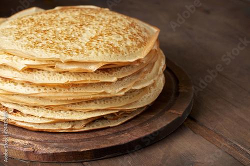Stack of russian pancake blini on a wooden background Fototapeta