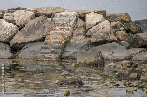 Wallpaper Mural staircase in the ocean rocks