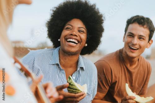 Diverse friends enjoying their beach picnic