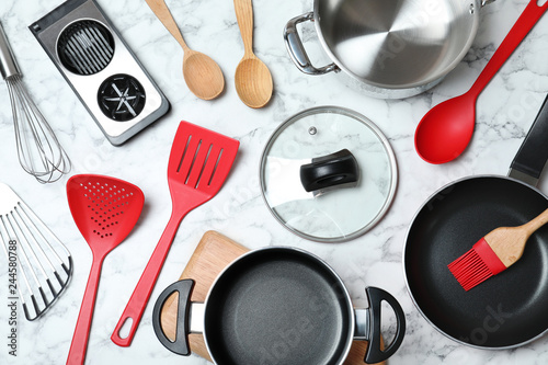 Flat lay composition with clean cookware on marble background