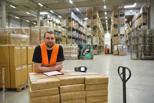 Photo smiling workers in a warehouse of a forwarding agency - trade and delivery of go