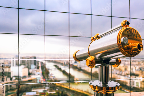 Obraz na płótnie Vintage coin operated binocular overlooking for Paris from top of Eiffel Tower