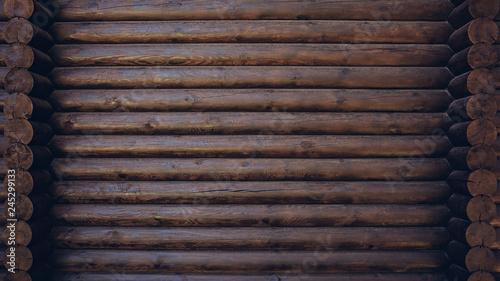 Fotografia Dark colored wooden cabin wall texture background