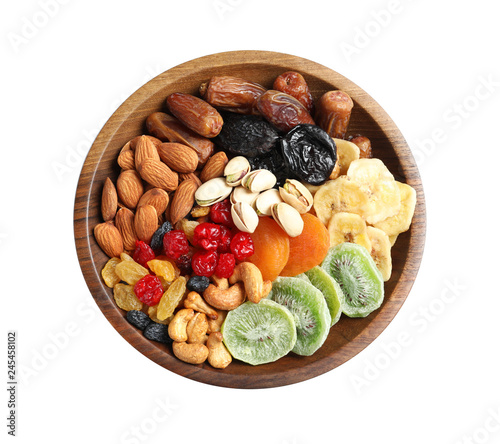 Bowl with different dried fruits and nuts on white background, top view