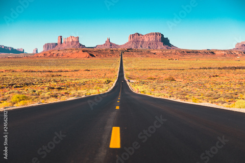 Long road in Monument Valley at sunset, USA