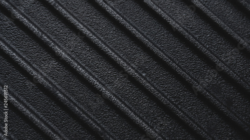Black rough cast iron griddle grill pan ribbed background