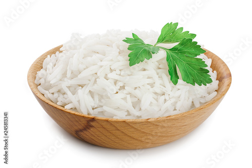 Fotografia rice in a wooden bowl isolated on white background