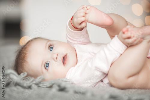 Obraz na płótnie Cute litttle baby at home in the bedroom