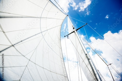 Close-up view of the mast and sails against cloudy blue sky Fototapeta