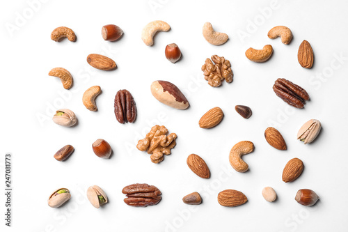 Composition with organic mixed nuts on white background, top view