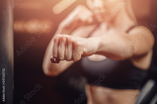 Fotografiet Fist fighter girl, concept of will to win. Self defense training