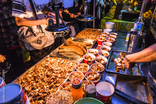 Fotografie, Obraz This snack food is a squid which is deep fried till golden brown and extremely crispy
