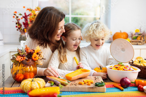 Family cooking pumpkin soup for Halloween lunch