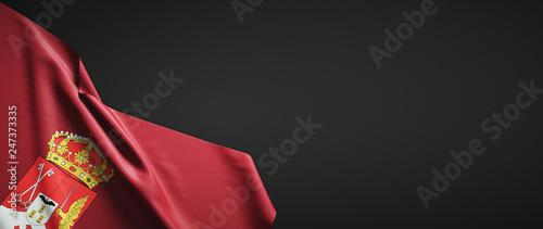 Bandera de Albacete de tela sobre fondo oscuro