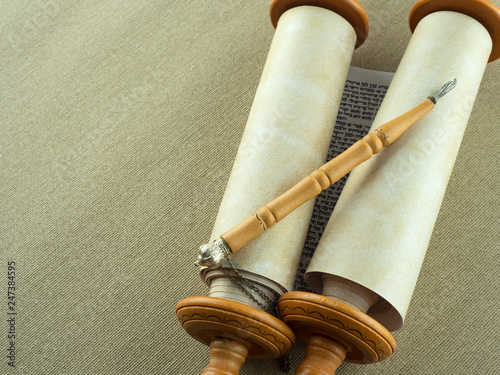Canvas Print Torah Scrolls on wooden fasteners with a pointer on a rough canvas