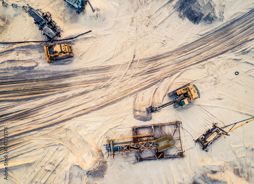 Canvas Print Aerial view of machinery and mine equipment near road on sandy surface