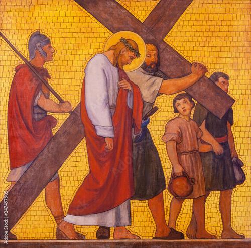 PRAGUE, CZECH REPUBLIC - OCTOBER 17, 2018: The painting Simon of Cyrene helps Jesus carry the cross in the church kostel Svatého Cyrila Metodeje by  S Fototapeta