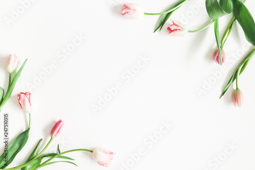 Flowers composition. Pink tulip flowers on white background. Valentines day, mothers day, womens day, spring, easter concept. Flat lay, top view, copy space
