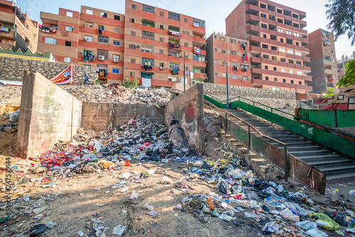 18/11/2018 Cairo, Egypt, pile of garbage lying on the streets of the African capital and accompanied by an unacceptable smear on a sunny day with flies around